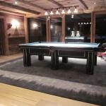 Pool/Snookertisch 9tf - Eigenproduktion im Kundenauftrag für ein 5-Sterne Hotel in Lech am Arlberg, Design: Bezug mit schwarzem Leder und aufgesetzten Chromeleisten